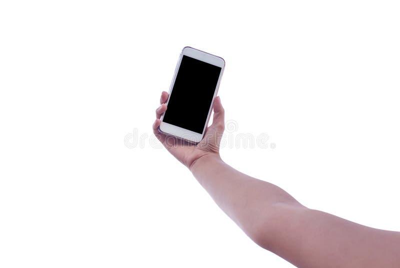 L'uomo utilizza il suo telefono cellulare fotografie stock libere da diritti