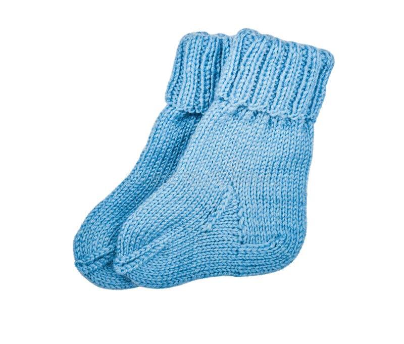 L'usura dei bambini - calzini tricottati del blu di bambino del bambino, bottini immagini stock