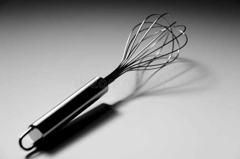 L'utensile della cucina sbatte il battitore immagini stock libere da diritti