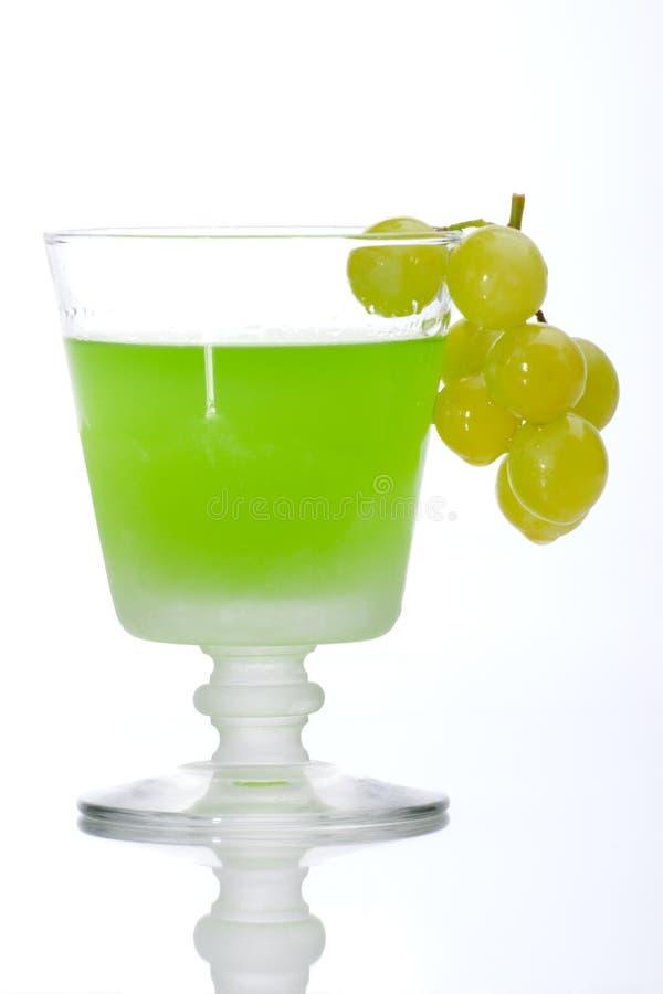 L'uva si è tuffata in liquore fotografia stock
