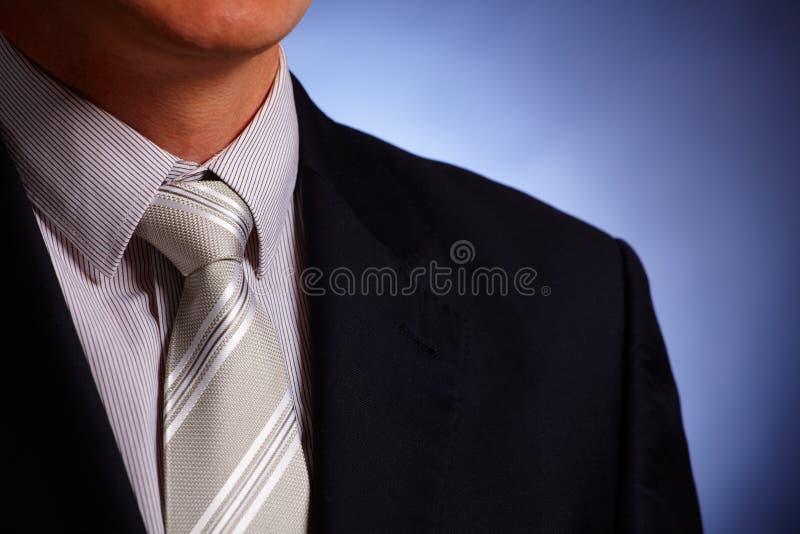 Laço do homem de negócios e close-up do terno fotografia de stock