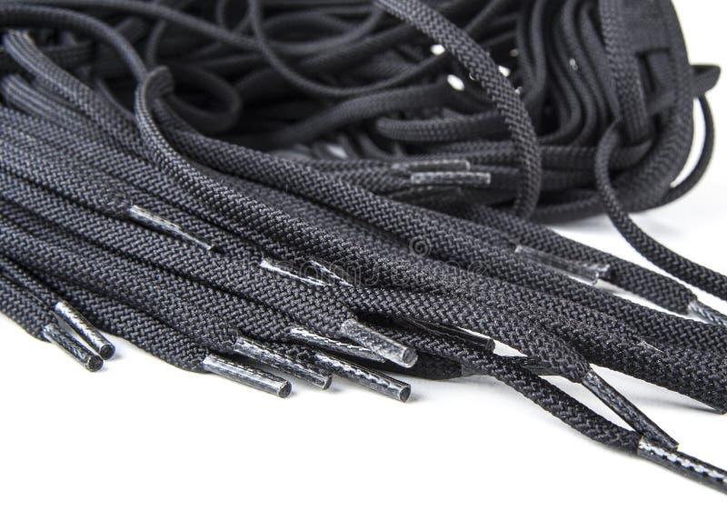 Laços de sapata de reposição pretos no fundo branco foto de stock royalty free