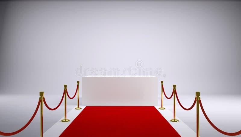 La alfombra roja y la caja blanca. Fondo gris fotos de archivo