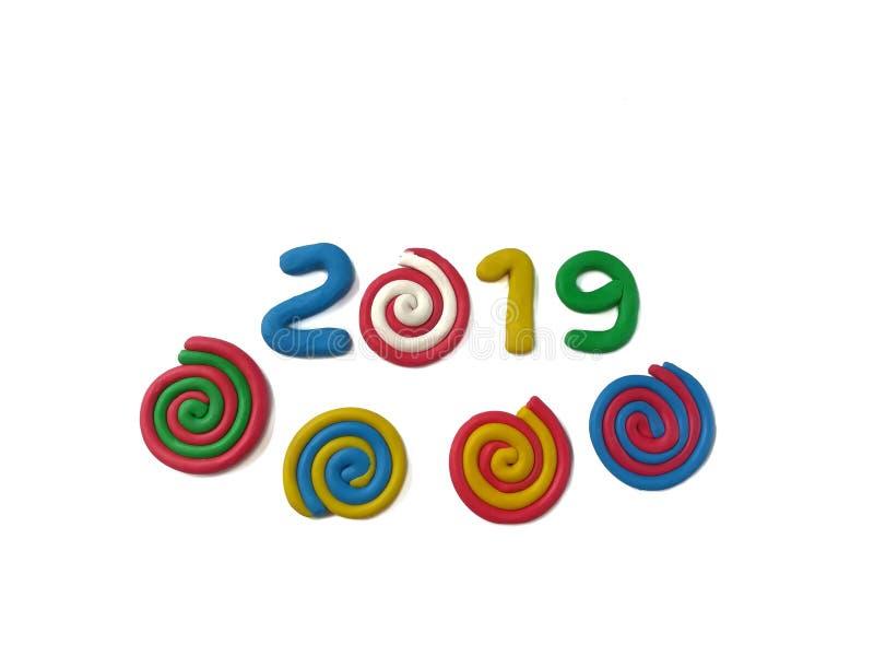 La arcilla colorida del plasticine, pasta 2019, adorna espiral fotografía de archivo