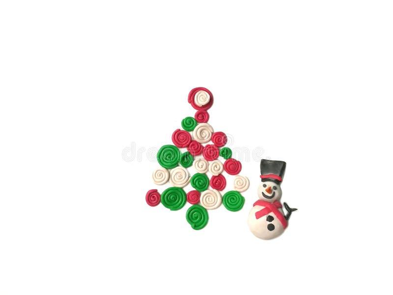 La arcilla linda del plasticine del muñeco de nieve, sonrisa dulce, adorna la pasta del festival foto de archivo libre de regalías