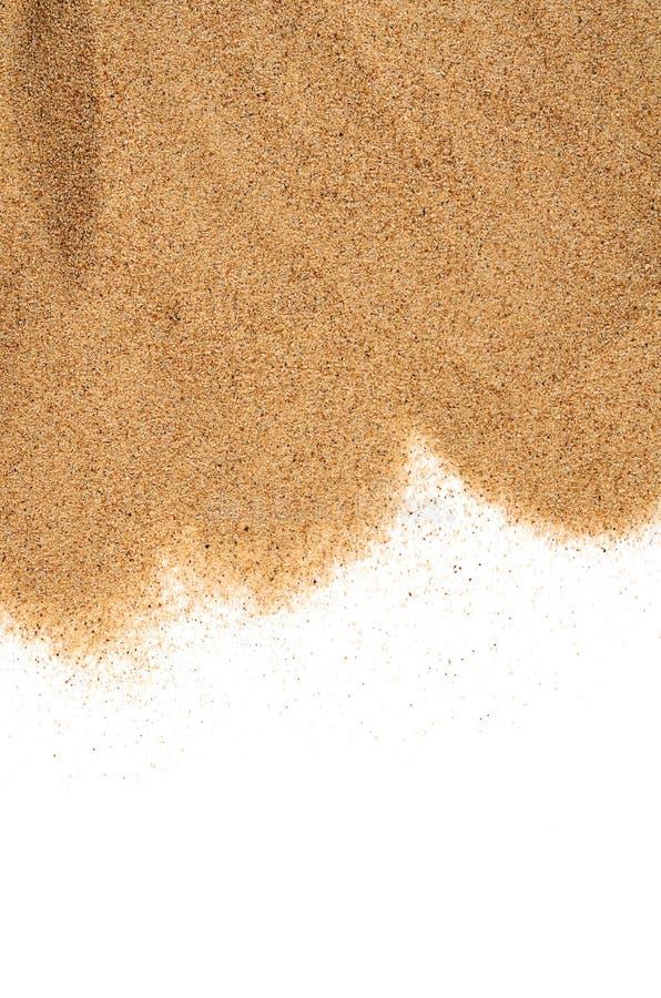 La arena aislada en el fondo blanco imagenes de archivo