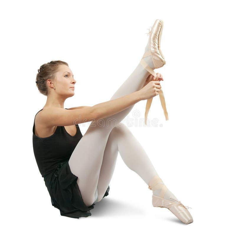 La bailarina pone el pointe fotografía de archivo