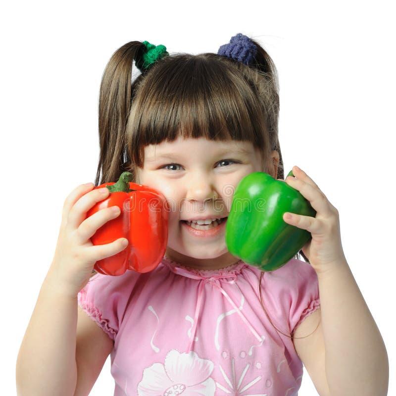 La bambina con il pepe di colore fotografia stock libera da diritti
