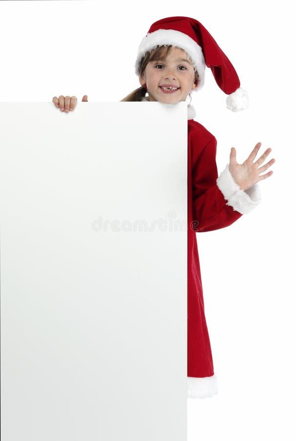 La bambina con Santa copre la tenuta della bandiera bianca fotografie stock