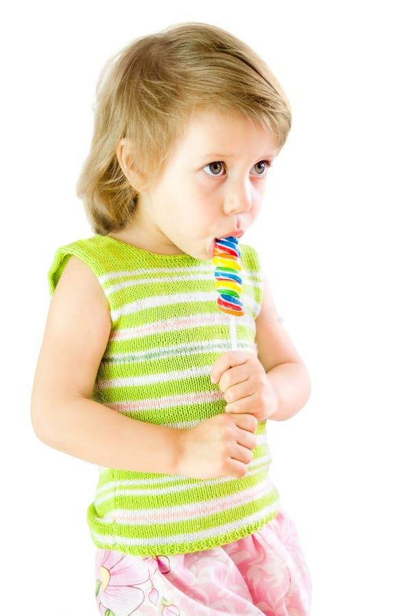 La bambina con un dolce fotografia stock