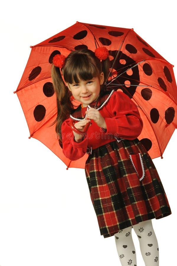La bambina con un ombrello immagini stock libere da diritti