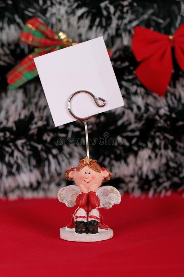 La bambina ha lista di obiettivi per il Natale immagini stock
