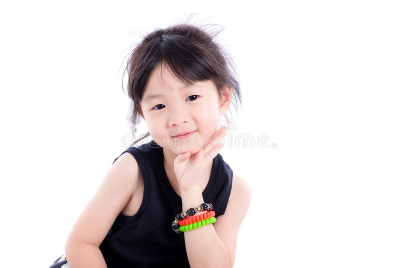 La bambina sorride sopra fondo bianco immagine stock libera da diritti