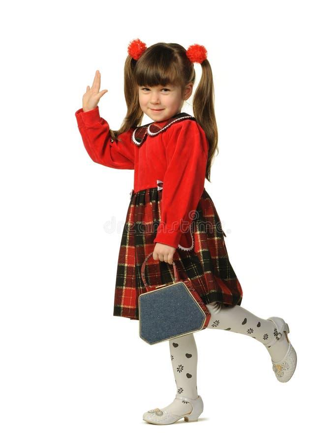 La bambina in un vestito rosso fotografie stock libere da diritti