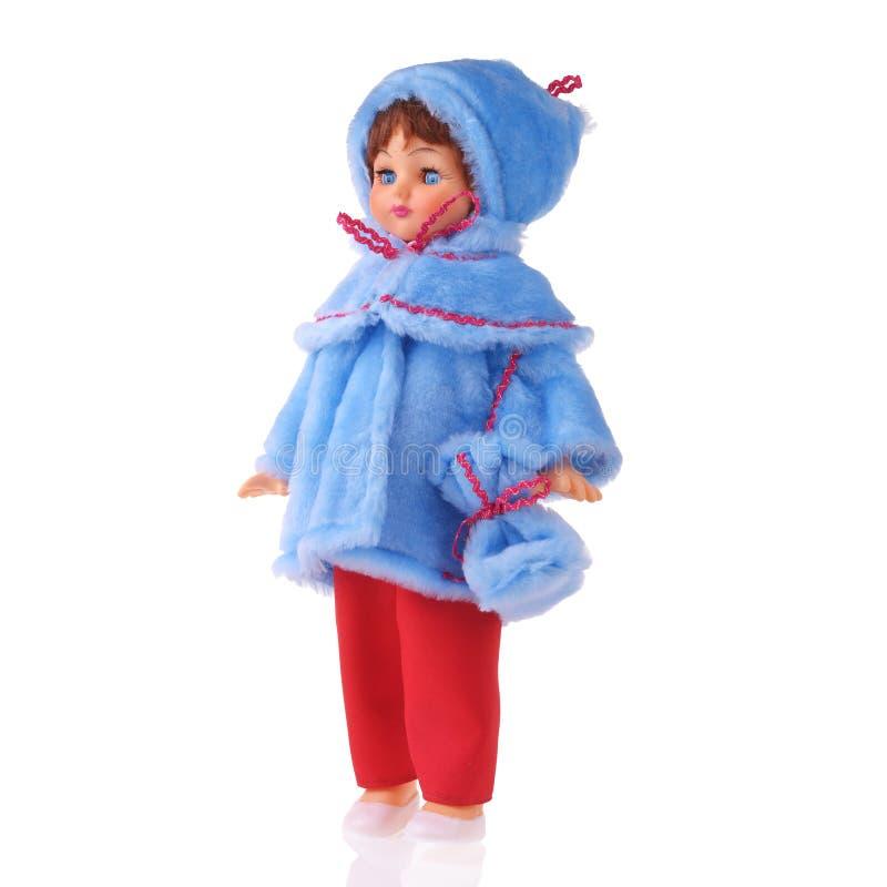 La bambola nel cappotto blu fotografia stock libera da diritti