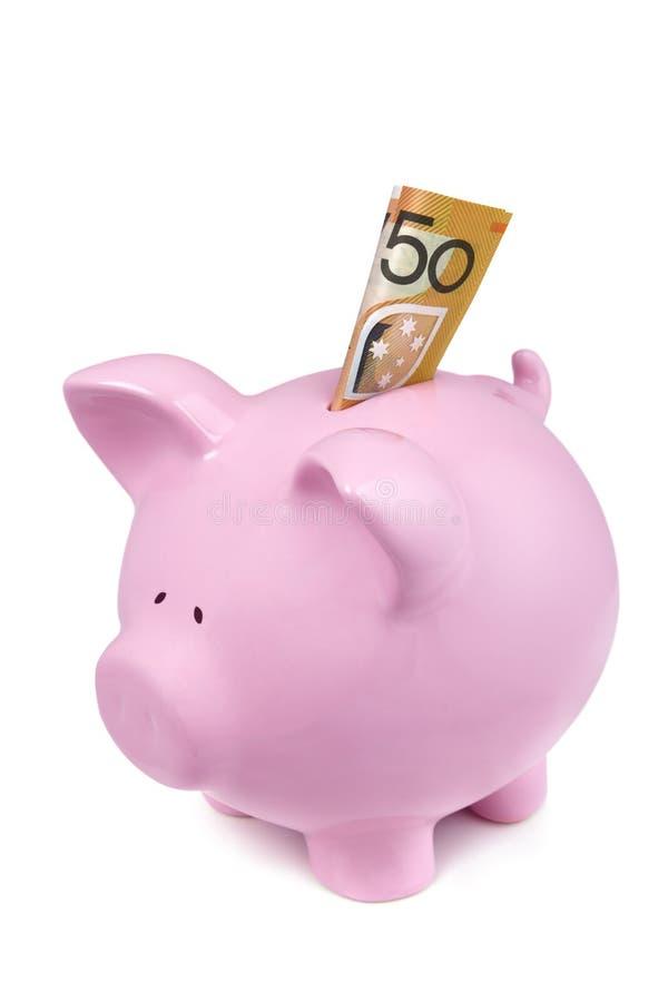 La Banca Piggy con l'australiano una nota dei cinquanta dollari fotografia stock libera da diritti