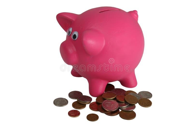 La Banca Piggy e monete fotografie stock