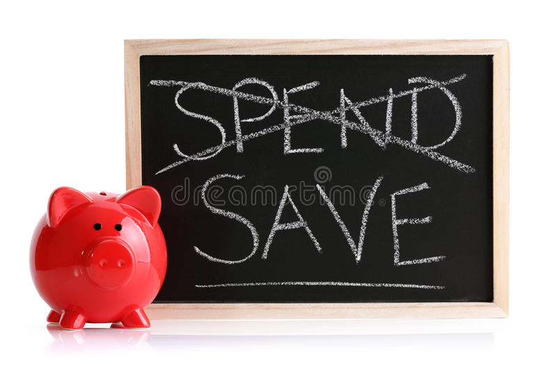 La banca Piggy spende o risparmia fotografia stock