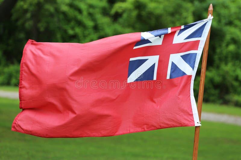 La bandera británica de Navy Red Ensign del comerciante para la flota civil imagen de archivo