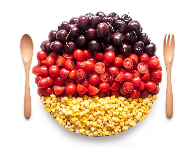 La bandera de Alemania hizo del tomate, de la cereza y del maíz foto de archivo