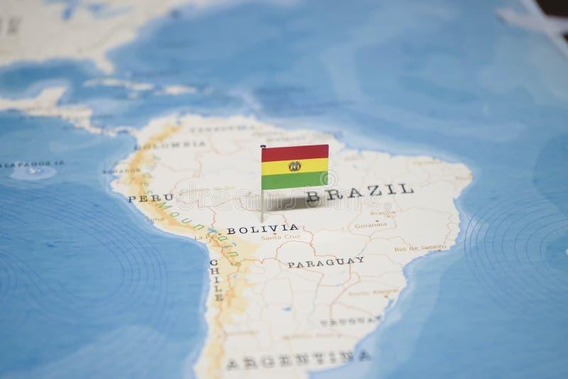 La bandera de Bolivia en el mapa del mundo fotos de archivo libres de regalías