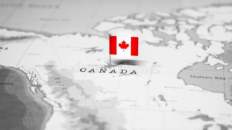 La bandera de Canad? en el mapa del mundo fotografía de archivo libre de regalías