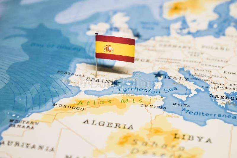 La bandera de Espa?a en el mapa del mundo fotografía de archivo