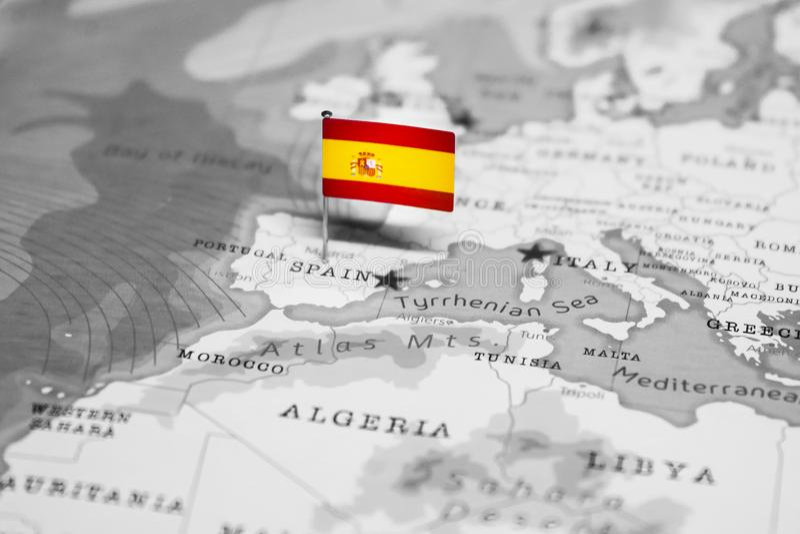La bandera de Espa?a en el mapa del mundo fotografía de archivo libre de regalías