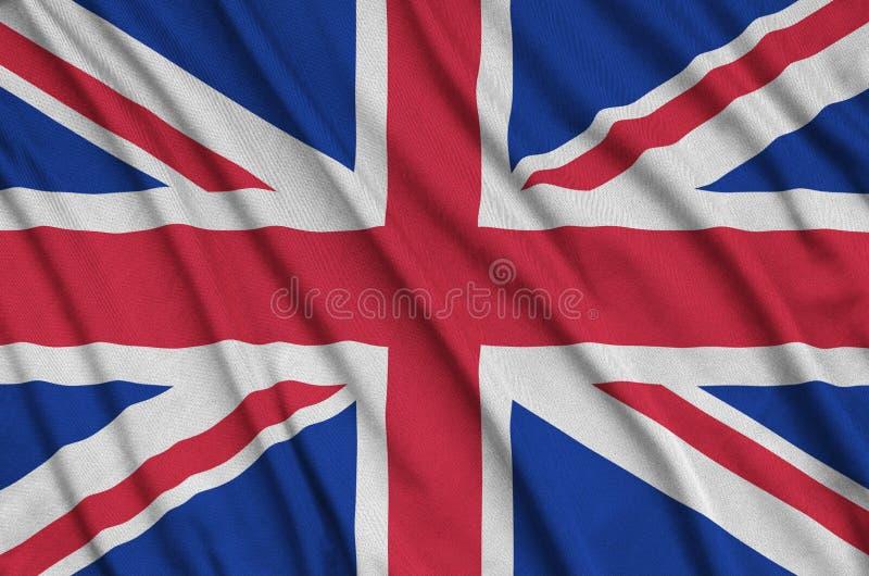 La bandera de Gran Bretaña se representa en una tela del paño de los deportes con muchos dobleces Bandera del equipo de deporte fotos de archivo libres de regalías