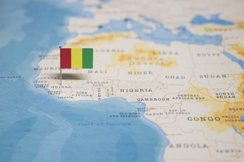La bandera de Guinea en el mapa del mundo imagen de archivo libre de regalías