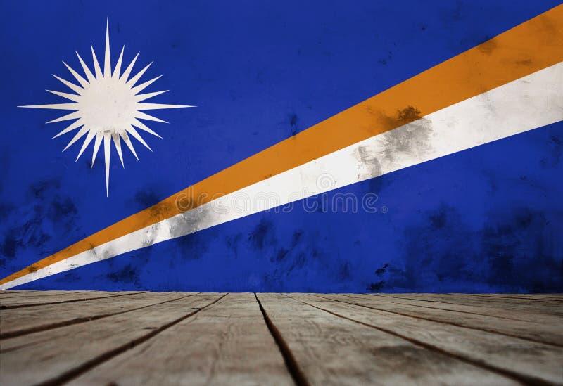 La bandera de Marshall Islands en una pared del yeso foto de archivo libre de regalías