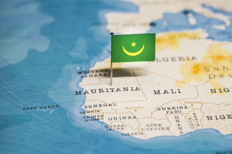 La bandera de Mauritania en el mapa del mundo fotos de archivo libres de regalías