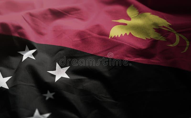 La bandera de Papúa Nueva Guinea desgreñó cercano para arriba imágenes de archivo libres de regalías