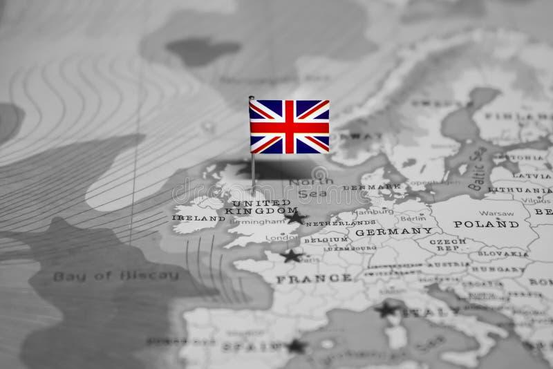 La bandera de Reino Unido en el mapa del mundo fotos de archivo