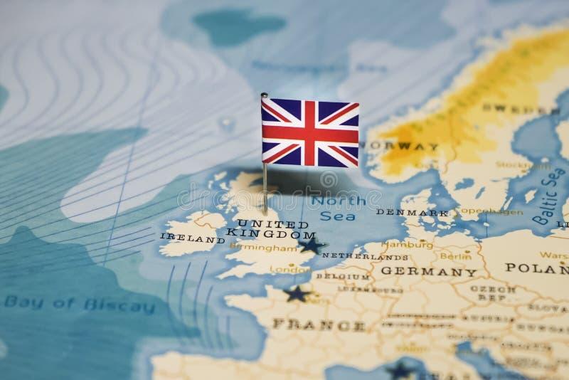 La bandera de Reino Unido en el mapa del mundo imagen de archivo