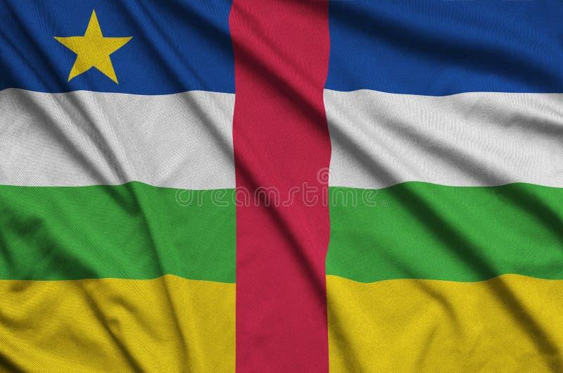 La bandera de la República Centroafricana se representa en una tela del paño de los deportes con muchos dobleces Bandera del equi fotografía de archivo