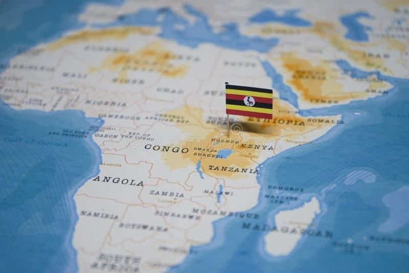 La bandera de Uganda en el mapa del mundo fotos de archivo libres de regalías