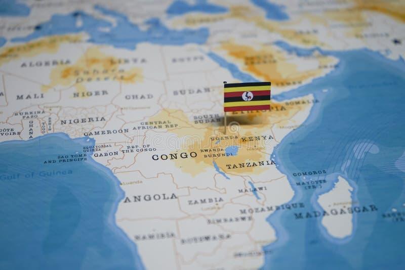 La bandera de Uganda en el mapa del mundo fotografía de archivo libre de regalías