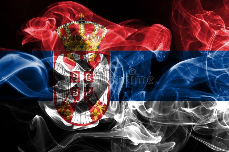 La bandera nacional de Serbia hizo del humo coloreado aislado en fondo negro fotos de archivo libres de regalías
