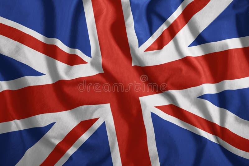 La bandiera britannica sta volando nel vento Variopinto, bandiera nazionale della Gran Bretagna patriotism immagini stock