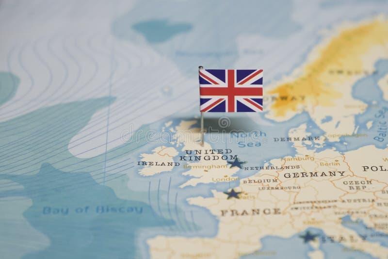 La bandiera del Regno Unito, Regno Unito nella mappa di mondo immagini stock libere da diritti