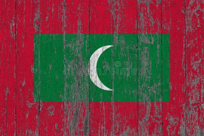 La bandiera delle Maldive ha dipinto fuori sul fondo di legno consumato di struttura fotografia stock libera da diritti