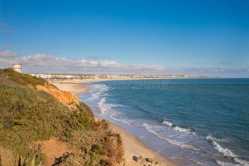 La Barrosa Beach of Chiclana de la Frontera in Cadiz from the mountain. La Barrosa Beach in Chiclana de la Frontera, one of the most famous and large beaches in royalty free stock photo