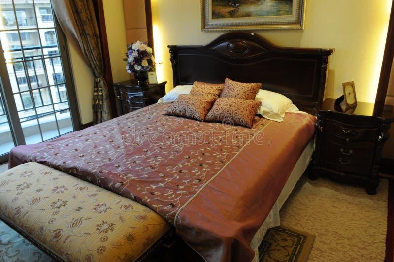 La base di formato del re in camera da letto fotografia stock