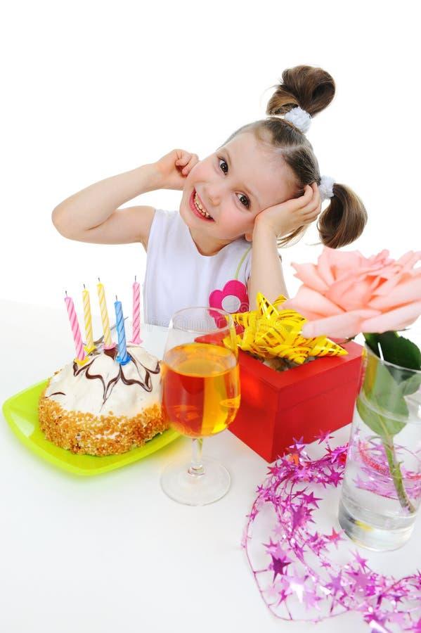La bella bambina celebra il compleanno fotografia stock