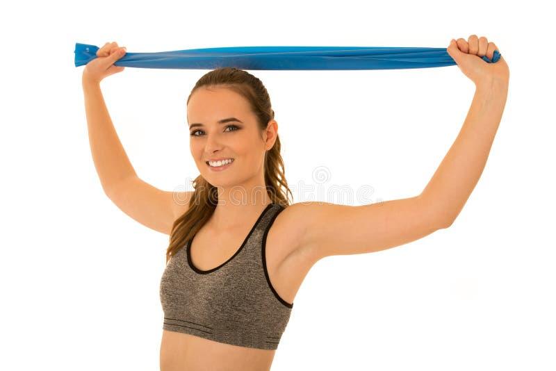 La bella donna di misura risolve con la banda elastica isolata sopra wh fotografie stock libere da diritti