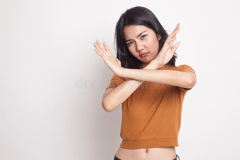 La bella giovane donna asiatica dice no immagini stock