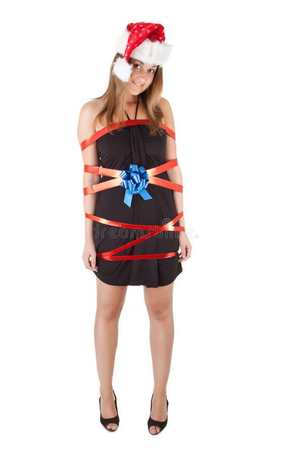 La bella ragazza della Santa gradice il regalo di Natale immagine stock