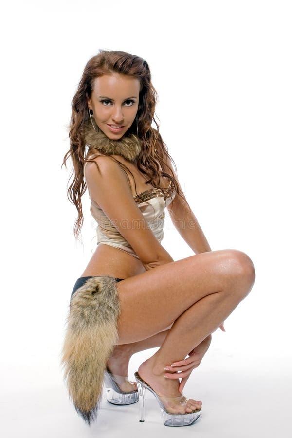 La bella ragazza in un vestito di dancing fotografia stock libera da diritti