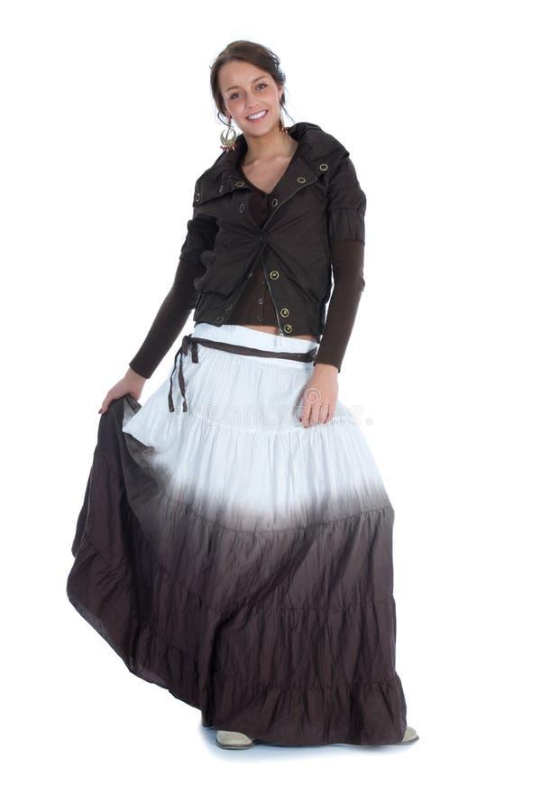 La bella ragazza in un vestito lungo fotografia stock libera da diritti